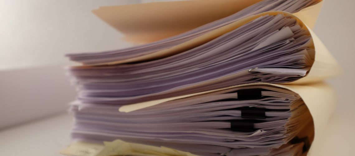 a-stack-of-folders-contracts-papers_t20_d1kjeJ
